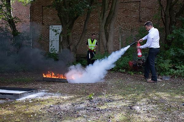 Employee Learning Fire Extinguisher Training