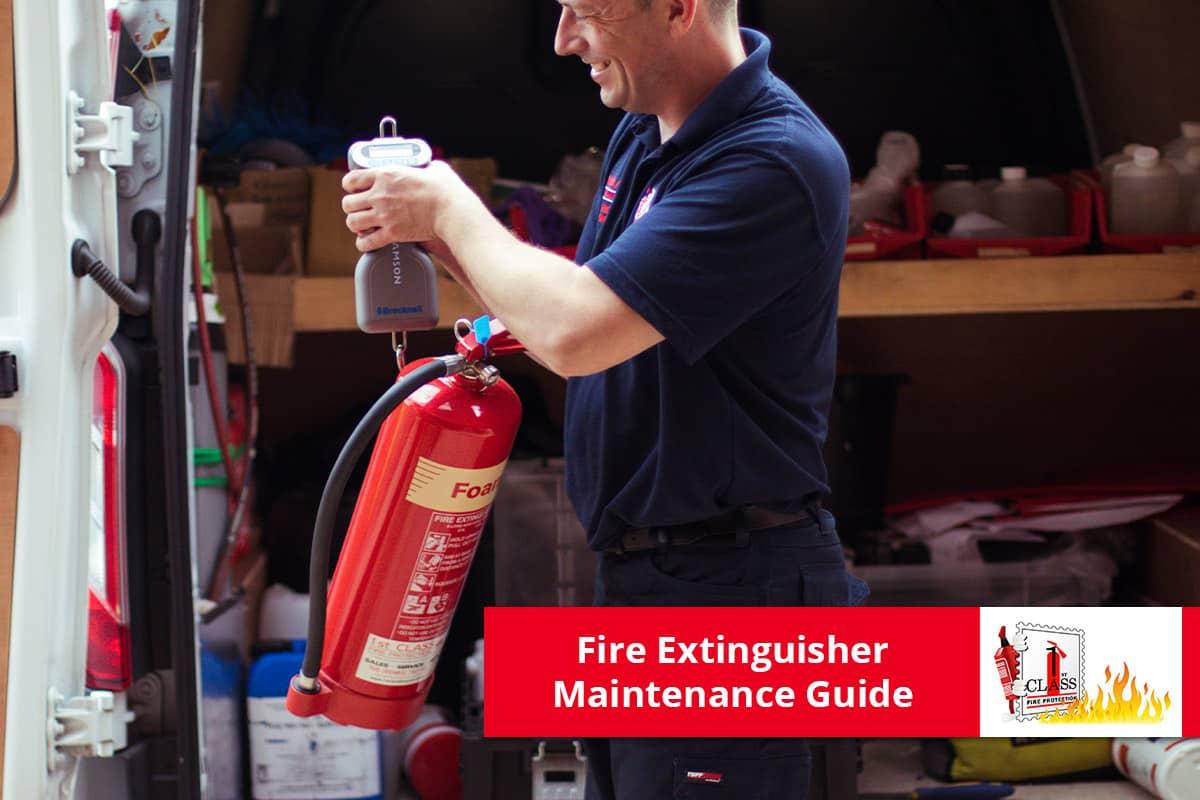 Engineer Checking Fire Extinguisher Maintenance